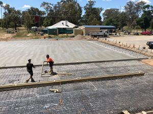 Commercial slab with washbay