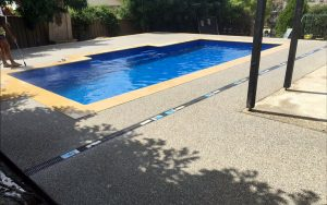 Pool with exposed aggregate surrounds
